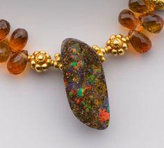 Australian boulder opal on faceted spessartite garnet and 18K gold #boulderopal #jewelry #oneofakind #spessartitegarnet #necklace #dreamtime #18K