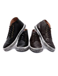 Level up your street credentials with the cool styling of these vintage wingtip sneakers. These shoes are certainly not your ordinary pair, and they can boost up your casual style in a snap especially when paired with a shirt and vest plus tapered pants! - Round toes - Lace up closure - Wing tips - Patterned perforations - Flat soles with vintage metal finish - High-top cut - Colors: Brown, Black