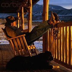 Colorado, USA — Cowboy on Front Porch in Rocking Chair — Image by © Ken Redding/CORBIS