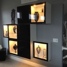 I chose the BESTA system because our home is sleek and contemporary and the BESTA system fit right into that category. Even though Ikea doesn't advertise or show using the black on the front of the white boxes, this most complimented our home since our interior is all black, white, & soothing grays. The final configuration gave us some additional needed storage as well as some needed display. The upper and lower black front boxes are cabinets and the center box has 4-drawers.
