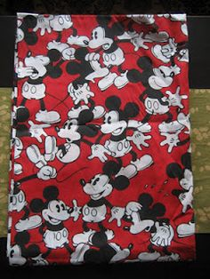 Mickey Mouse Bed Sheets.  I had this set... and the comforter too.  I am a long time Mickey Mouse fan- but mostly the old black and white version of Mickey.