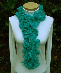 Ruffled Lace Scarf - PA-132 - A crochet pattern from Nancy Brown-Designer. This frilly, flirty, fabulous scarf is designed for the Intermediate Crocheter and works up quickly and easily. The scarf starts with a center strip of shells and then three rows on either side are worked with increases in each row to create ruffles. This pattern PDF can be purchased at my Ravelry Pattern Store for $3.69, just click on the photo.