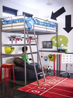 The raised sleeping area of the SVARTA loft bed creates the floor space for a cool hang-out spot underneath.