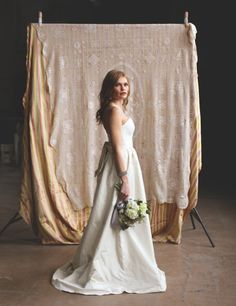 Photographed by Aaron Snow Photography. http://www.aaronsnowphotography.com/blog  Makeup by Jennifer McLaughlin.  Styled by Kimber Hall of Blueberry Hill Events. Bride, wedding dress, bouquet, pretty, beautiful, portrait, lighting, natural, backdrop, Oklahoma City farmers market, photographer, wedding