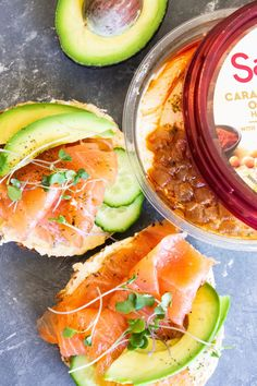 This perfect toasted Breakfast Smoked Salmon Bagel is layered with cream cheese, caramelized onion hummus, smoked salmon, avocado and cucumbers! Spicy Hummus, Roasted Garlic Hummus, Garlic Spinach, Avocado Hummus, Salmon Avocado, Fresh Avocado, Hummus Recipe, Smoked Salmon Breakfast, Smoked Salmon Bagel