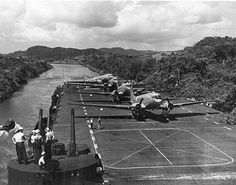 The aircraft-carrier USS PHILIPPINE SEA (CV-47) at the Panama Canal with R4D-5 Skytrains en route to the Antarctic,during the Operation High- jump,in 1947: