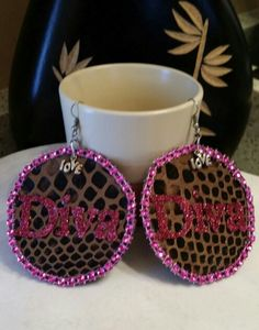 Handmade round dangle DIVA earrings with a touch of bling,  glitter and love.