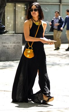 Easy Breezy from Vanessa Hudgens' Street Style  Oh la la! The singer-actress pairs bold yellow accessories with a romantic black jumpsuit.