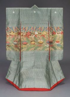 Kimono (uchikake) Japanese, Edo period, 19th century, Long-sleeved outer robe (uchikake) with design of floral medicine ball ornaments (kusudama) and hanging bamboo screens across the middle of the robe in green, yellow, brown, white and blue silk and gilt paper strip discontinuous supplementary patterning wefts on a blue-gray silk damask ground with woven vertical serpentine foliage pattern; three oak leaf crests embroidered in white silk along the upper back. MFA