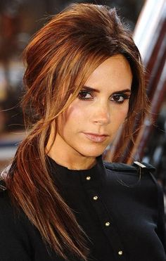 love this dark auburn color with lighter highlights shaping the face. i even like the cut too.