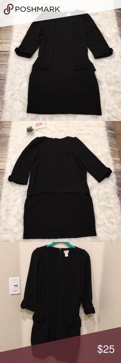 H&M Black Dress EUC.  So adorable!!  Has a textured black fabric.  Shoulder puff out a little due to stitching, sleeves and waist accented with same fabric flowers, and a faux belt in the back.  Color is black most like close up of flower on sleeve.  Zips up the back and has a single button closure at the top of zipper.  Please see photos for approximate measurements of item lying flat.  🖤Thanks for stopping by! H&M Dresses Midi