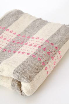 Snazz up a blanket with embroidery.