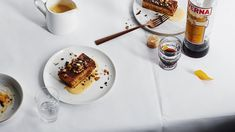 Olive oil cake with orange-scented custard and nuts