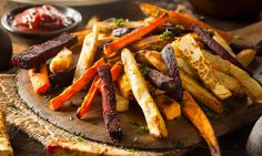 Try this easy recipe for oven-roasted duck fat french fries made with mixed root vegetables. Duck fat adds subtle flavor and does wonders for texture. Healthy Salty Snacks, Healthy Chips, Healthy Recipes, Roasted Vegetables, Veggies, Glazed Vegetables, Root Vegetables, Squash Fries, Roasted Chicken And Potatoes