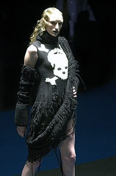 The skull, one of the label's signature motifs, appears here on a knitted dress that featured in the autumn/winter 2001-2 What a merry-go-round collection. Staged two days after he'd been awarded designer of the year by the British Fashion Council for the third year running, McQueen's references this season were the 1922 vampire film Nosferatu and the 1968 musical Chitty Chitty Bang Bang