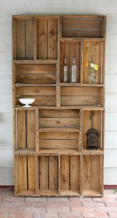 If I could find enough antique apple crates I would make this bookshelf in a heartbeat.  I love the look of it!