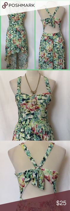 Floral, high-low, backless summer dress, sz large Adorable and sexy, backless summer dress has built-in, invisible shorts for modesty. The bust features slightly molded cups. High-low design, zipper. Great condition. Forever 21 sizing. Forever 21 Dresses High Low