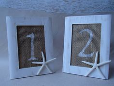Wedding table number frames. White and burlap with starfish! Hawaiian, tropical or beach theme. Purchase through ParadiseBridal on Etsy by clicking the picture.