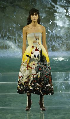 Once upon a time, princesses danced across enchanted waters in lavishly adorned gowns. The Legends and Fairy Tales collection features romantic colors and ethereal materials such as organza, silk, and tulle. Fendi's craftsmanship shines with printed and hand painted fabrics, embroidered lace and rich velvet jacquards. A truly fantastical collection that could have only come to life in the Trevi Fountain.