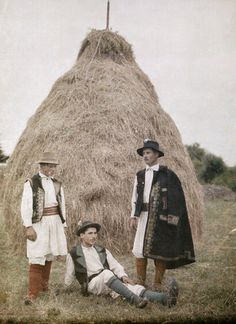 Three men in holiday apparel pose by a large hay stack, Romania, 1934 Romanian Girls, Europe On A Budget, City People, Medieval Town, Second World, Travel Around The World, National Geographic, Places To Go, Transylvania Romania