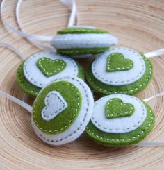Round felt ornaments - set of 5 circles in green and white. $24.50, via Etsy.