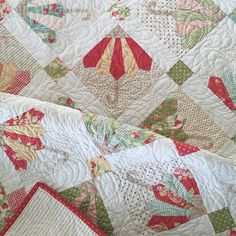 A freshly washed and crinkly 'Jolly Brollies' quilt in Fig Tree's 'Strawberry Fields'  The beautiful quilting is by Maureen Shenton...