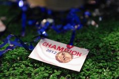 """These lil """"confettis"""" were a closeup of my son's state champion t-shirt with his medal hanging on it.  I just copied it as a 'contact size' print and printed out bunches of them and used as confetti on every table"""