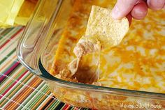 'Texas Trash' 1 package cream cheese 1 cup sour cream 2 cans (16 ounces, each) refried beans 1 packet taco seasoning 2 cups cheddar cheese, shredded 2 cups monterey jack cheese, shredded..