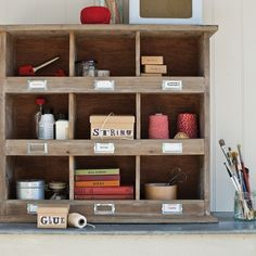 Wooden Wall Unit - from COX & COX in the UK:  An amazingly useful piece of furniture around the home for storing bits and pieces. Nine good-sized labelled boxes in a great looking wall-hanging unit. Try it for size in the office, playroom or utility room. Made from fir wood.  £115