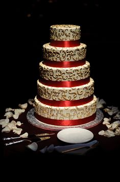 Five layer white, gold, and red wedding cake - photo by Kenny Nakai Photography