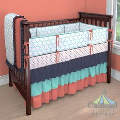 Crib bedding in Teal Sweetheart, Solid Coral, Solid Teal, Solid Navy, Coral Hearts. Created using the Nursery Designer® by Carousel Designs where you mix and match from hundreds of fabrics to create your own unique baby bedding. #carouseldesigns