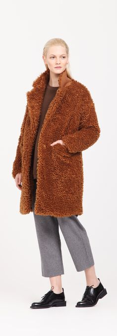 This fluffy faux fur coat is crafted in a double breasted style with a wool blend collar stand, front pocket and finished with thin quilted lining. http://www.paisie.com/collections/new-in/products/fluffy-teddy-bear-coat