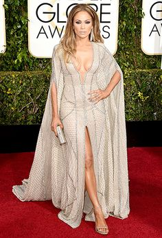 Jennifer Lopez The American Idol judge made jaws drop in a sparkling Zuhair Murad dress, complete with a plunging neckline, up-to-there slit, and a cape.