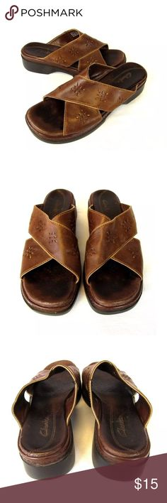 Clarks Brown Leather Sandals Slides Sz 7 Brand:   Clark's Type:  Mule Sandals, criss cross upper with perforation detail Color: Brown Size:  7M  Condition: Barely worn Clarks Shoes Sandals