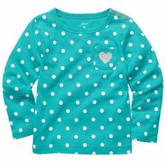 A glitter heart pocket detail on this top is fun and playful to wear with her favorite bottoms.