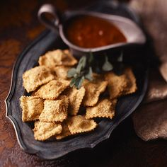 Crispy baked ravioli with marinara dipping sauce