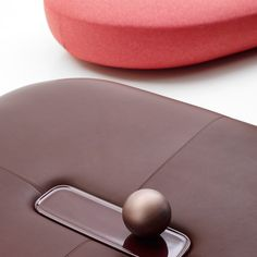 B&B Italia products by Doshi Levien and Naoto Fukasawa // The poufs are covered in either fabric or leather, and feature a central dimple created by an oversized button