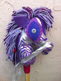 These hobby horses are amazing! Handmade toy for Christmas that will foster creativity. Added bonus: mama made from recycled and upcycled materials!