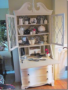 Secretary Desk - bought one from an antique store that is in some need of some serious TLC - thinking of painting it white like this...