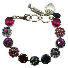 Beautiful Mariana statement bracelet, style B-4084. Large sized circle tennis bracelet, hand set with 11 faceted, round cut Swarovski Crystals. Decorated with 10 pointed petal flower accents, 5 petal scalloped flowers, and 2 layer circles. Includes 3 charms: polished heart, small Swarovski drop, and Mariana branded tag. Matches jewelry with Mariana Color Way 4801 - Crown Jewelry. Contains the following crystal colors: Bright Fuchsia Pink, Aqua Blue, Apple Green Bracelet is 8 inches long w...