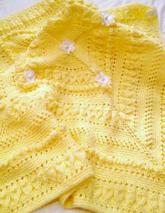 Knitting Pattern for Buttercup Baby Blanket  The designer says the pretty textured patterns are easier than they lookand easy to memorize.The finished size is approx. 36x36ins/92x92cms, It is knitin 4 triangles and sewn together.  Click pin to see with other baby blankets  Or go directly to the pattern on Etsy at http://www.awin1.com/cread.php?awinaffid=234273&awinmid=6220&p=https%3A%2F%2Fwww.etsy.com%2Flisting%2F489656847%2Fbaby-buttercup-blanket-knitting-pattern