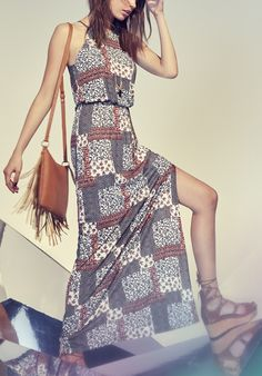 Adoring this casual patchwork-printed maxi dress. It's designed with a shoulder-baring high-neck bodice for a classic look.