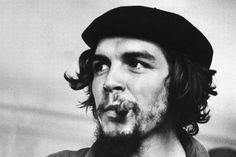 """Cuban rebel Ernesto """"Che"""" Guevara w. lit cigar clenched between his teeth & his left arm in a sling. Fidel Castro, Che Quevara, Ernesto Che Guevara, Free To Use Images, The Ugly Truth, Popular Culture, Revolutionaries, Famous People, Socialism"""