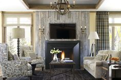 Vail Ramshorn Unit 12 | Bardes Interiors....Love the reclaimed wall for fireplace.