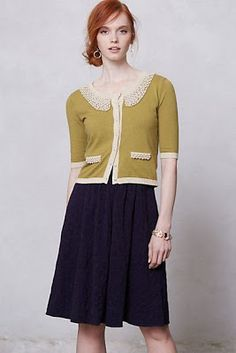 Pea green and pearl cardigan with Peter Pan collar, dark A-line midi skirt.