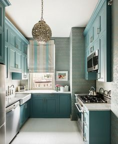 Stacked Cabinets, small kitchen design, turquoise cabinets, color in the kitchen
