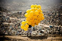 A man sells balloons in a cemetery in the capital Lima, Peru. Winner, Peru, National Awards: (© © Milko Torres Ramirez, 2014 Sony World Photography Awards) # Award Winning Photography, Photography Awards, Sony, World Photography, Amazing Photography, Conceptual Photography, Color Photography, Creative Photography, Somerset