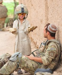 "soldier in Afghanistan - I don't know if it says ""war is fun"" or ""a uniform makes us all the same"""