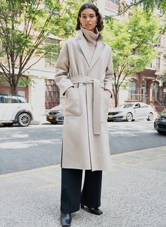 The Wilfred Chateau Coat is an oversized wool wrap coat. This is a handcrafted, oversized wrap coat with dropped shoulders, a self belt and front patch pockets. Engineered to deliver warmth up to 0°C / 32°F, it's expertly tailored with luxurious, double-faced virgin wool from a premier Italian mill.