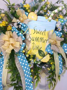 Whimsical Lemonade Blue and Yellow Mesh Spring and Summer Wreath by WilliamsFloral on Etsy https://www.etsy.com/listing/399335519/whimsical-lemonade-blue-and-yellow-mesh
